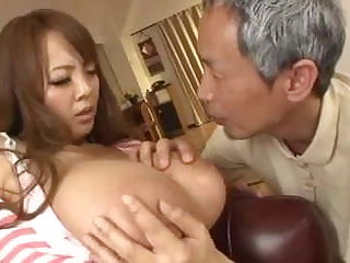 Busty asian having an old man sucking her breasts