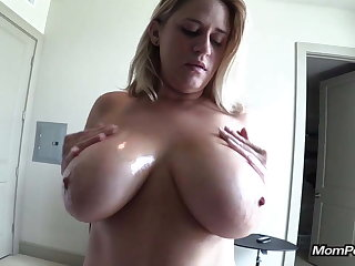 Huge natural tits MILF sucks me off POV