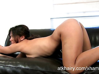 Exotic Lucie plays with her hairy pussy