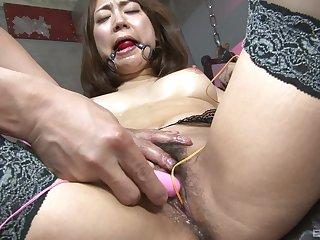 Obedient Asian slut in rough scenes of BDSM sex