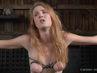 Redhead chick Ashley Lane tied up and poked with sex toys