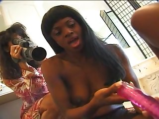 Black babe is indeed lucky to have a hot GF who loves to fuck her with her toy