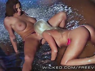 Two perfect lesbians fuck in the pool